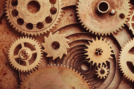 creative industry: Steampunk background from mechanical clocks details over old metal background. Inside the clock, gears Stock Photo