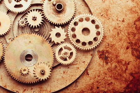 clock: Steampunk background from mechanical clocks details over old metal background. Inside the clock, gears Stock Photo