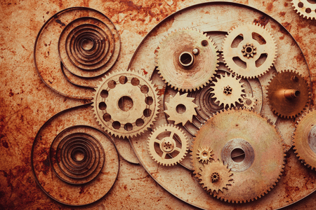 Steampunk background from mechanical clocks details over old metal background. Inside the clock, gears Stockfoto
