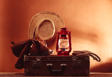 stetson: Old vintage suitcase and leather footwear with stetson and kerosene lamp Stock Photo