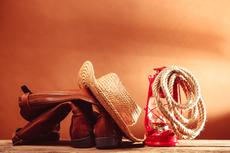 stetson: Old vintage cowboy tools - leather footwear, stetson, rope and kerosene lamp