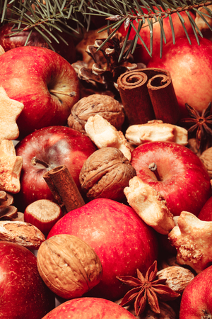 stick of cinnamon: Apples, cones, nuts and cookies with spices. Aroma Christmas