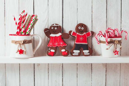 christmas cooking: Christmas gingermen family on a kitchen wooden shelf Stock Photo