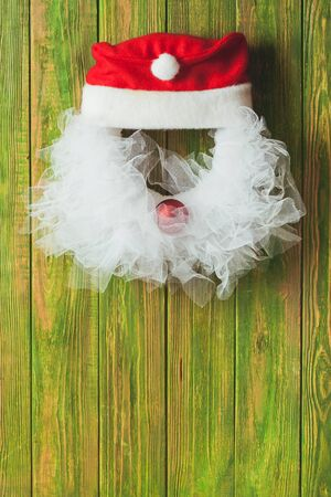 lace like: Christmas wreath like Santa head from lace and red bauble on the wooden door