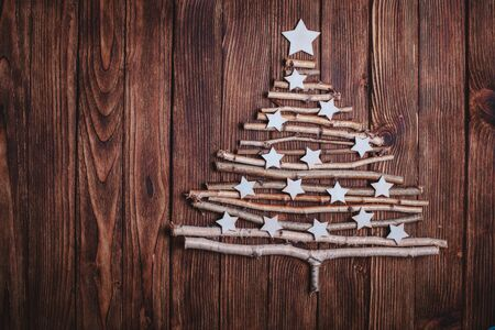 birch branches and white stars in a shape of christmas tree stock photo 49834809