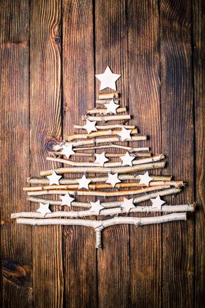 old desk: Birch branches and white stars in a shape of christmas tree