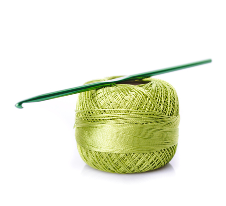 spiral: Crochet green color threads isolated on white background