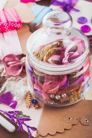 craft materials: Scrapbooking craft materials in a glass bottle Stock Photo