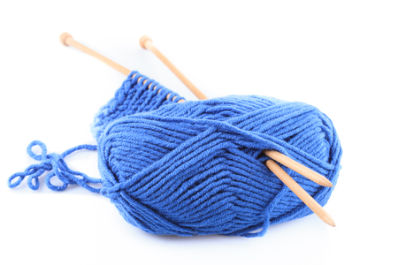 isoalated: Knitting close up with blue woven thread isoalated on white Stock Photo