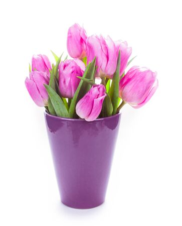life event: Tulips and eggs isolated on white. Easter decorations.
