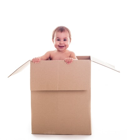 conform: A small child crawls out of the box isolated