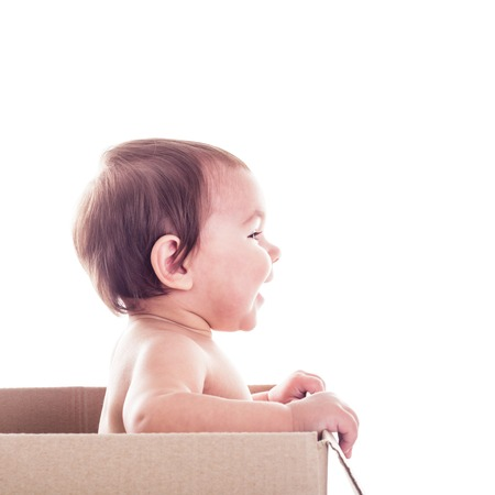 surprise box: A small child in  the box isolated, side view Stock Photo