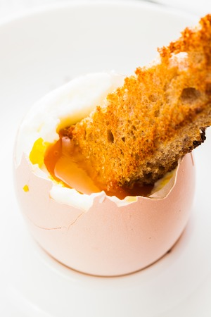eggcup: The soft-boiled egg in an eggcup with toasted bread