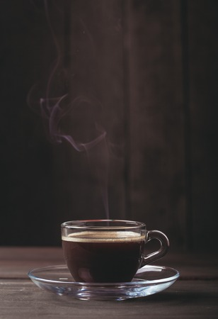 fume: Cup of coffee with fume on the wooden background