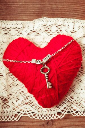 key words art: love letters on the chain close up on red background
