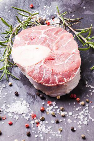 shank: Raw fresh slice of meat - cross cut veal shank on a slate board