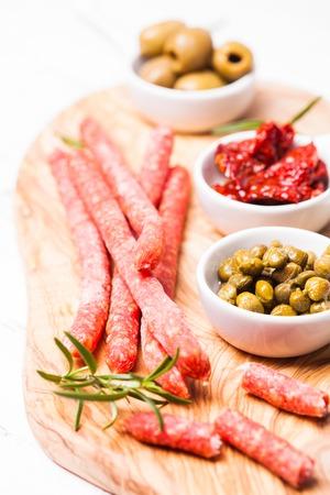 antipasto: Salami antipasto sausage on the olive board Stock Photo