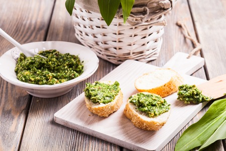 vegetable background: Wild garlic pesto on french bread, healthy appetizer