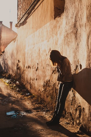 ghetto: Sad teenage girl crying in the dirty poor ghetto
