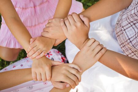 three girls: Friends forever - three girls hold hands together, close up arms
