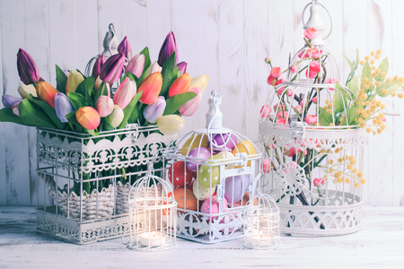 Easter decorations - shabby chic birdcages with flowers and eggs