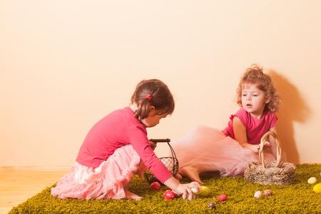 egg hunt: Girls with baskets on the Easter Egg hunt Stock Photo