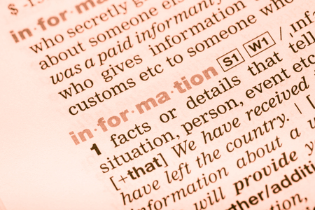 English dictionary: Close-up of English dictionary page with the interpretation of the word information