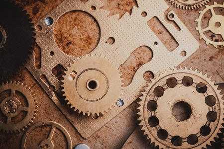 the details: Steampunk background from mechanical clocks details over old metal background. Inside the clock, gears Stock Photo