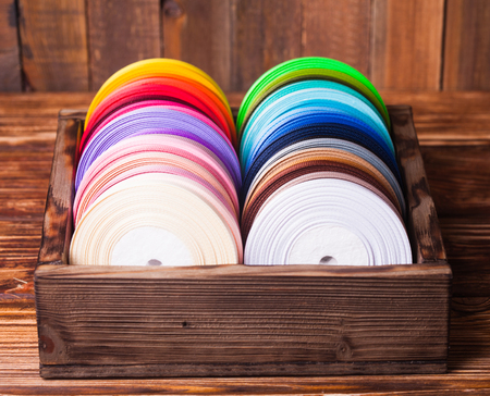 favours: Various colors ribbon bobbins in vintage wooden box