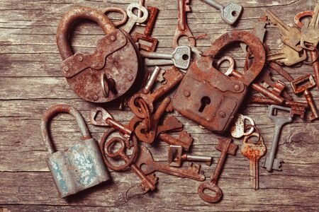old keys: old keys locks over vintage wooden table Stock Photo