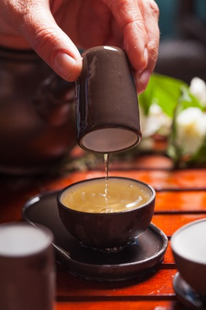 chinese tea ceremony: Close-up table with  earthenware for Chinese tea ceremony Stock Photo