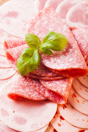 salami slices: Cutting sausage and cold salami slices close up Stock Photo