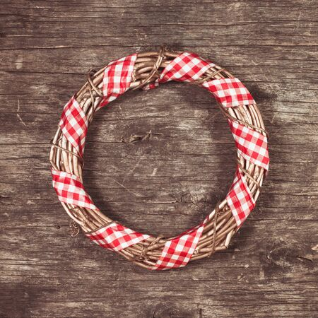 Gold Christmas wreath with red gingham ribbon Stock Photo