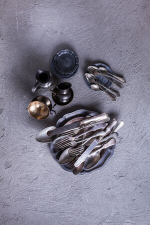 Vintage cutlery and utensils over concrete background. Vintage collection, top view Stock Photo