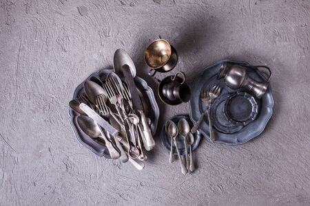 vintage cutlery: Vintage cutlery and utensils over concrete background. Vintage collection, top view Stock Photo