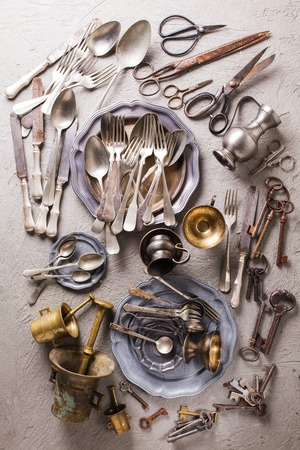 collectible: Rarity collectible goods - old cutlery, scissors, keys of different shapes and sizes, old mortar with pestle.