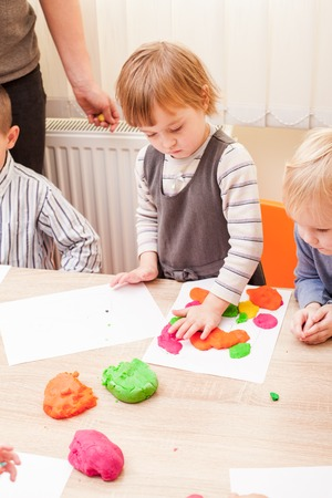 sculp: Children are making a figure plasticine on the table