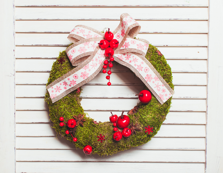 breen: Christmas natural wreath with moss and berries Stock Photo