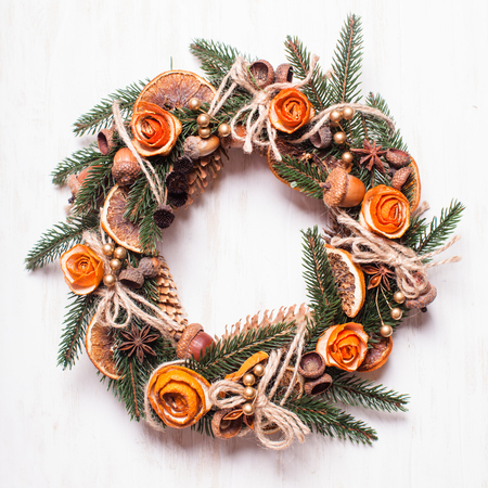 Christmas aromatic eco wreath with dry orange and anise stard, decorated tangerine peel roses