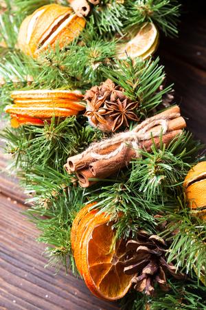 Christmas aromatic eco wreath with dry orange and cinnamon sticks, closeup details