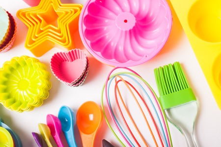 measuring cup: Rainbow silicone confectionery utensils on a white background