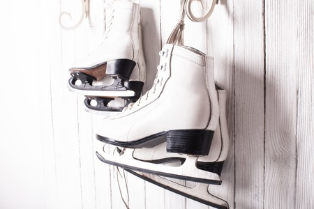 winterday: Two pairs of skates hanging on the hook. Family skating concept Stock Photo