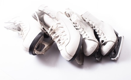 Two pairs of skates close up on the ice Stock Photo