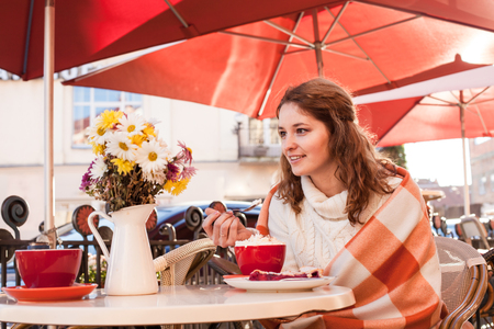 enjoyment: Woman in cafe outdoor