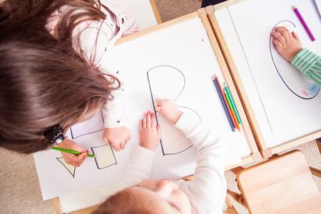 Preschoolers learn letters Фото со стока