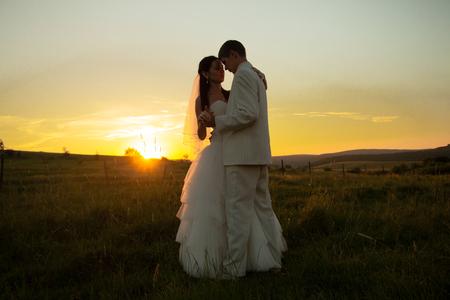 Wedding couple on sunset photo