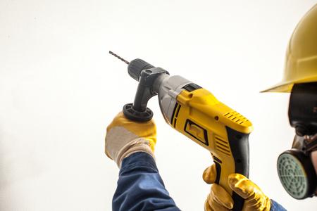 Female worker drills