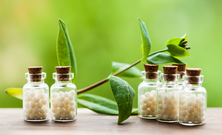 Homeopathy pills in vintage bottles