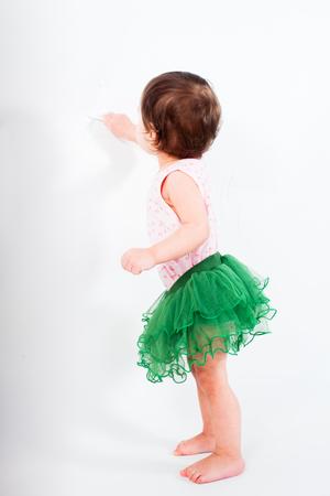 prank: Baby girl is writting Stock Photo