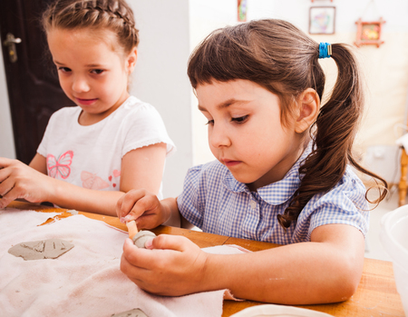 Child mades with plasticine Stock Photo